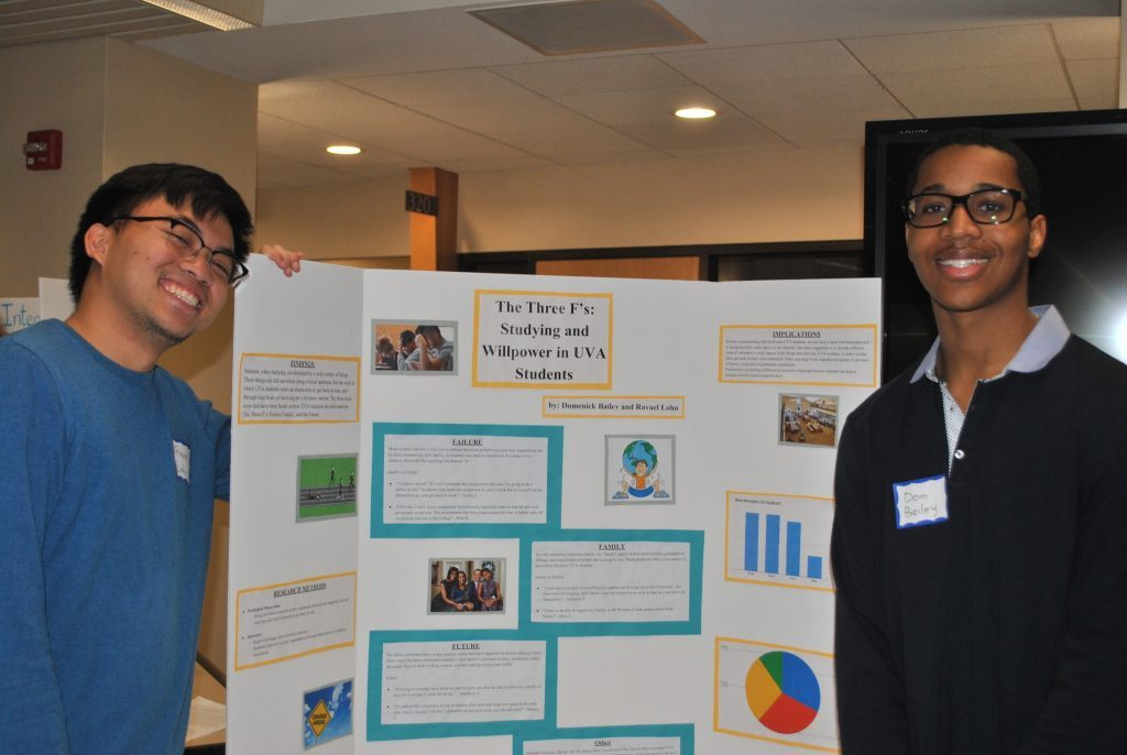 Two students with a poster