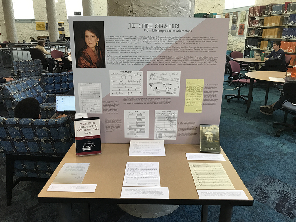 Exhibition panel on a table, displaying a photo of Professor Shatin and selections of sheet music, letters, and drawings accompanied by text.
