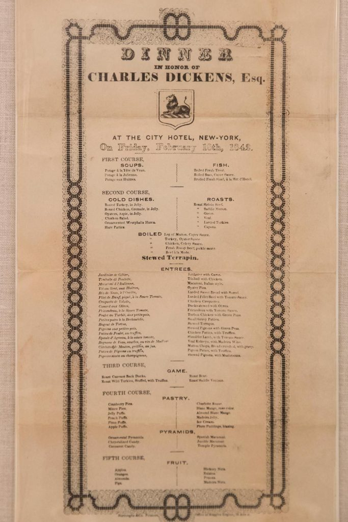 "Menu for a dinner in honor of Charles Dickens' tour of America, includes ""stewed pigeons with green peas."""